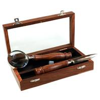 Magnifying glass and letter opener in wooden box