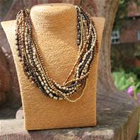 Necklace, 11 strands, brown and gold coloured