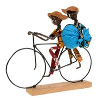 Model bike, cyclist x 2 with bag, wooden base