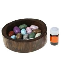 Stone aroma diffuser in wooden tray, lemongrass