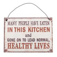 "Plaque ""Many People Have Eaten in This Kitchen"""