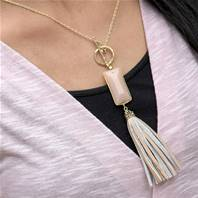 Necklace, leather tassel with pink block